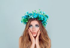 Stunned woman with floral headband looking up royalty free stock images