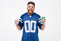 Excited man fan holding beer bottle. Royalty Free Stock Image