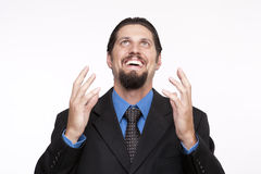 Image of an excited young businessman looking upwards Royalty Free Stock Photo