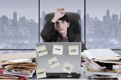 Exhausted businesswoman working in the office Royalty Free Stock Photography