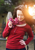 Image of a face beautiful female model in a colorful cotton scarf closeup on sunset background Stock Photography
