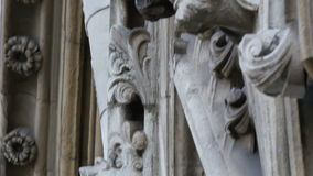 An image of the faces sculpted on the wall of Westminster Abbey stock video footage