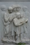 Image of fascinated reading children in stone, stone-carving Stock Photography