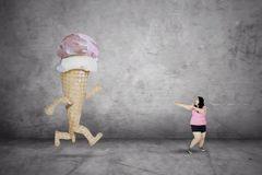 Fat woman running away from an ice cream stock images