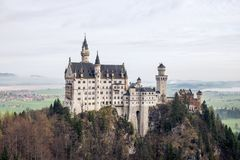The castle of neuschwanstein germany. This image features the castle of neuschwanstein Germany in the autumn stock photo