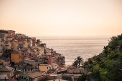 The italian city of Manarola. This image features the italian city of Manarola with a calm sea in the distance stock photo
