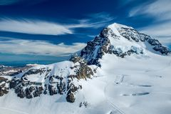 The jungfraujoch oberservatory in switzerland. This image features the jungfraujoch oberservatory in the alps of Switzerland stock photo