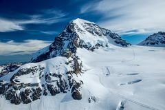 The jungfraujoch oberservatory in switzerland. This image features the jungfraujoch oberservatory in the alps of Switzerland stock photos