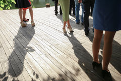 Image of feet of young people standing outdoor. Mixed race friends standing stock image