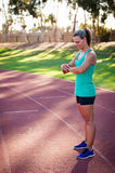 Image of a female athlete adjusting her heart rate monitor Stock Photos