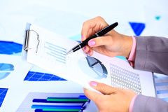 Image of female hand pointing at business document during Royalty Free Stock Photos