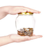 Image of female hand putting a coin into glass bottle Stock Images