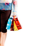 Image of female holding shoppingbags in her hand Royalty Free Stock Photos