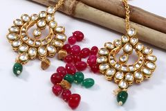 A image of a female jewelry chain with stones,For girl wear earring. A image of a female jewelry chain with stones.Closeup of Indian woman ear rings, artificial stock images