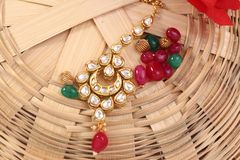 A image of a female jewelry chain with stones,For girl wearing mangtika. A image of a female jewelry chain with stones.Closeup of Indian woman ear rings stock photo