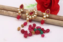 A image of a female jewelry chain with stones,For girl wearing mangtika. A image of a female jewelry chain with stones.Closeup of Indian woman ear rings stock images