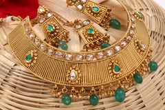 A image of a female jewelry chain with stones.For girls and women matching earrings, mangtika and necklace. A image of a female jewelry chain with stones stock photography
