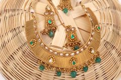 A image of a female jewelry chain with stones.For girls and women matching earrings, mangtika and necklace. A image of a female jewelry chain with stones stock image