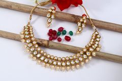 A image of a female jewelry with stones.For girls and women matching earrings and necklace. A image of a female jewelry chain with stones.Closeup of Indian stock image