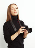 Image of female photographer with camera looking out for a best Stock Photo