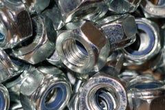 The image of female screws closeup. Many female iron screws closeup background royalty free stock photos