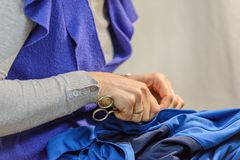 Female tailor at work in the atelier. Image of female tailor at work in the atelier royalty free stock image