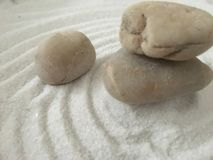 Zen stones on the raked sand wallpaper. Image of a few balancing zen stones on the takes white sand wallpaper stock images