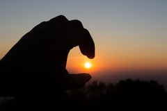 image of finger sun and morning sky . Royalty Free Stock Images