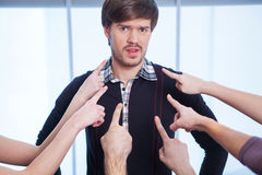 Image of fingers pointing at one man. Royalty Free Stock Photography