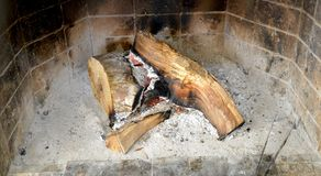 Image of a fireplace with wood and ash. Image of a Stock Image