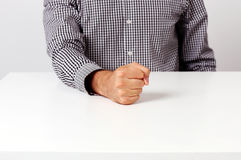 Image of fist on a white table Stock Photos