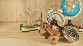 image of five horn beetle and wooden plane Stock Images