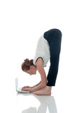 Image of flexible businesswoman working on laptop Royalty Free Stock Photos