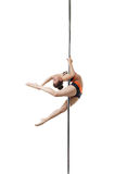 Image of flexible dancer spinning on pylon Royalty Free Stock Photography