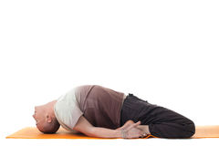Image of flexible man lying in relaxed position Royalty Free Stock Images