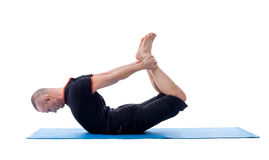 Image of flexible yogi posing in difficult asana Royalty Free Stock Image