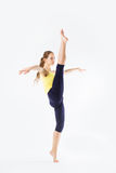 Image of flexible young beautiful girl doing vertical split Royalty Free Stock Photo