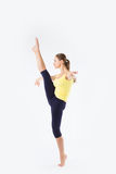 Image of flexible young beautiful girl doing vertical split Royalty Free Stock Photos
