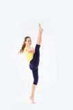 Image of flexible young beautiful girl doing vertical split Royalty Free Stock Photography