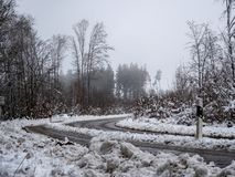 Image of foggy and snowy winter road royalty free stock image