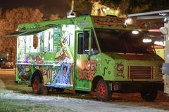 Image of a food truck in the park at night. MIAMI, FL, USA - DECEMBER 4, 2017: Image of a food truck in a park at night stock photography