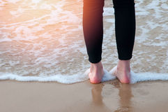 The image of foot on the beach Royalty Free Stock Photography