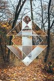 Image of forest in autumn and the sacred geometry symbol. Collage Stock Images