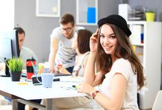 Image of four successful businesswomen looking at camera. Image of successful businesswoman looking at camera at meeting royalty free stock photography