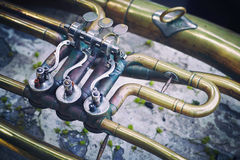 The image of a fragment of a vintage musical instrument. stock photos