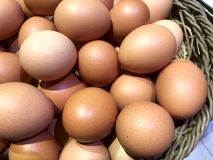 Image of fresh brown chicken eggs in a basket. Happy Easter. stock photography