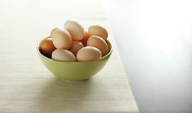 Image of fresh brown chicken eggs in a plate Royalty Free Stock Images