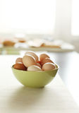 Image of fresh brown chicken eggs in a plate Royalty Free Stock Image