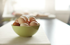 Image of fresh brown chicken eggs in a plate Stock Image