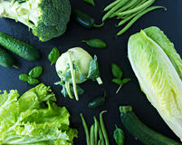 Image of fresh green vegetables. Green healthy vegetables  in black table Royalty Free Stock Image
